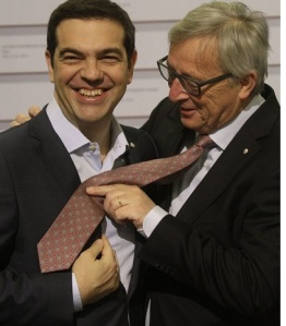 epa04761785 President of the European Commission Jean-Claude Juncker jokes with tie-less Prime Minister of Greece Alexios Tsipras (L)during arrivals at Eastern Partnership Summit in Riga, Latvia, 22 May 2015.  EPA/VALDA KALNINA