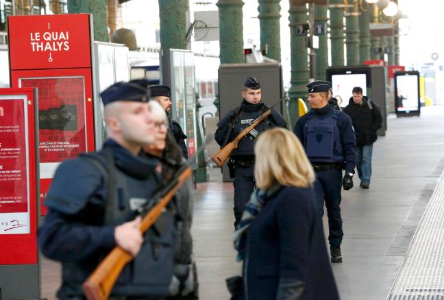Police patrol the Gare du Nord train station the morning after a series of deadly attacks in Paris , November 14, 2015. REUTERS/Yves Herman