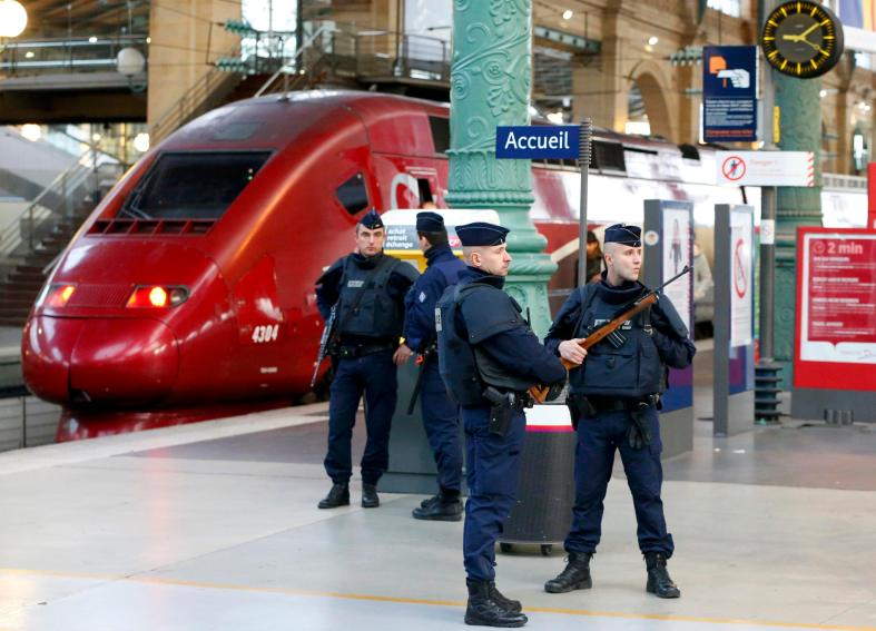 Police patrol the Gare du Nord train station near a high-speed international Thalys train the morning after a series of deadly attacks in Paris , November 14, 2015. REUTERS/Yves Herman