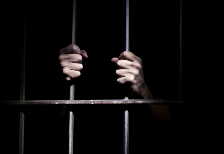 prison-bars-hands